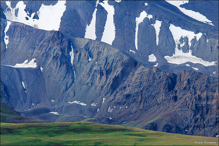 The imposing grante wall on the north face of Francs Peak (13,153') contrasts sharply with summer green on Phelps Mountain. Francs...