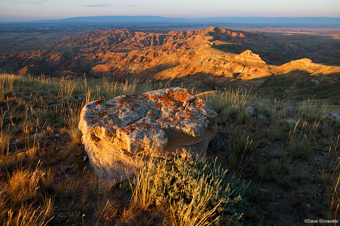 A summer sunset paints badlands of the McCullough Peaks gold.