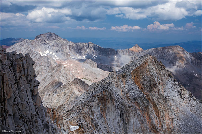Capitol Peak (14,130') stands above ridges of stone at the top of the Elk Mountain Range. The view is from Snowmass Mountain...