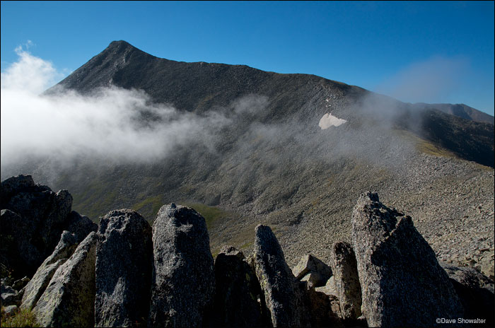 Culebra Peak (14,069') encircled by morning clouds from a high approach ridge. Culebra is on the Cielo Vista Ranch the...