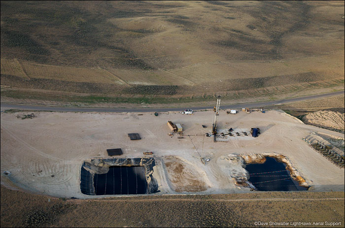 An aerial view of produced water ponds and a new gas drilling pad on the pInedale Anticline. The ponds will store fracking...