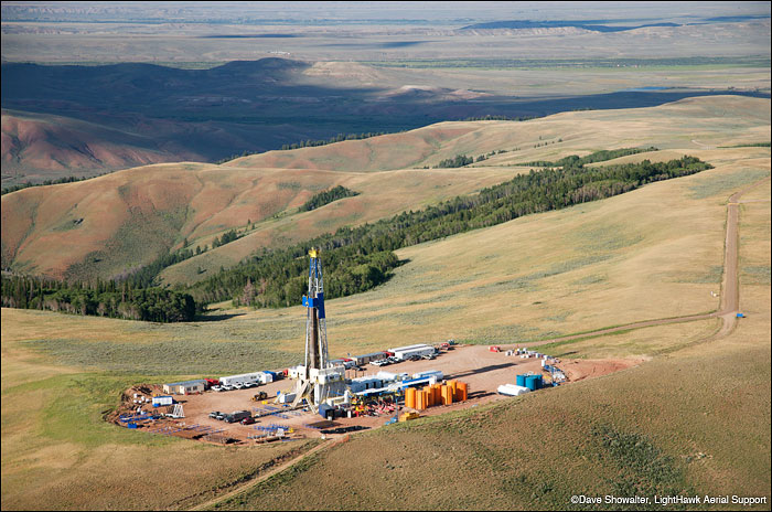 A natural gas drilling rig and service road in the alpine zone of the southern Wyoming Range.