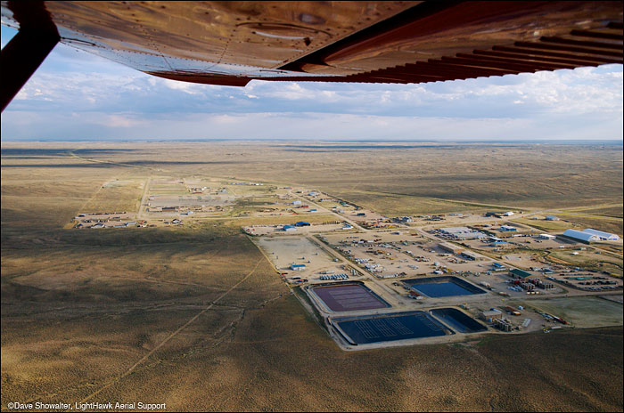 LightHawk pilot Chris Boyer flew me over the Jonah Field to document high density natural gas drilling in Sublette County...