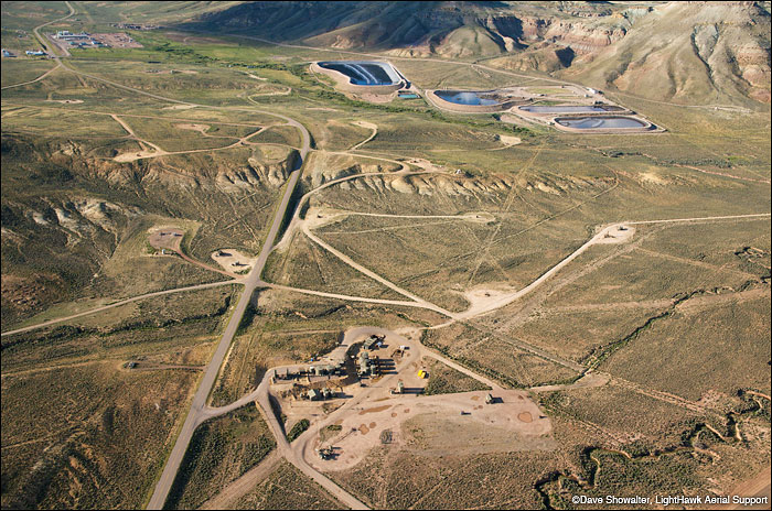 An aerial view of the industrial natural gas field in LaBarge, Wyoming. The ponds are produced water holding ponds with...