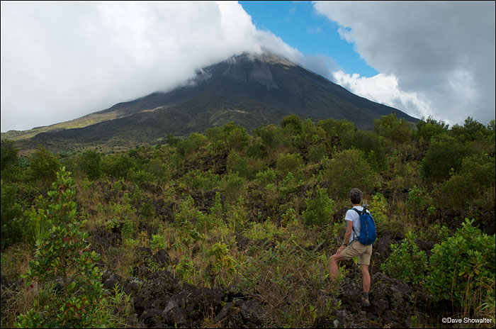 Marla watches as clouds swirl around the summit of Vulcan Arenal (5,479'), a recently dormant volcano near La Fortuna.