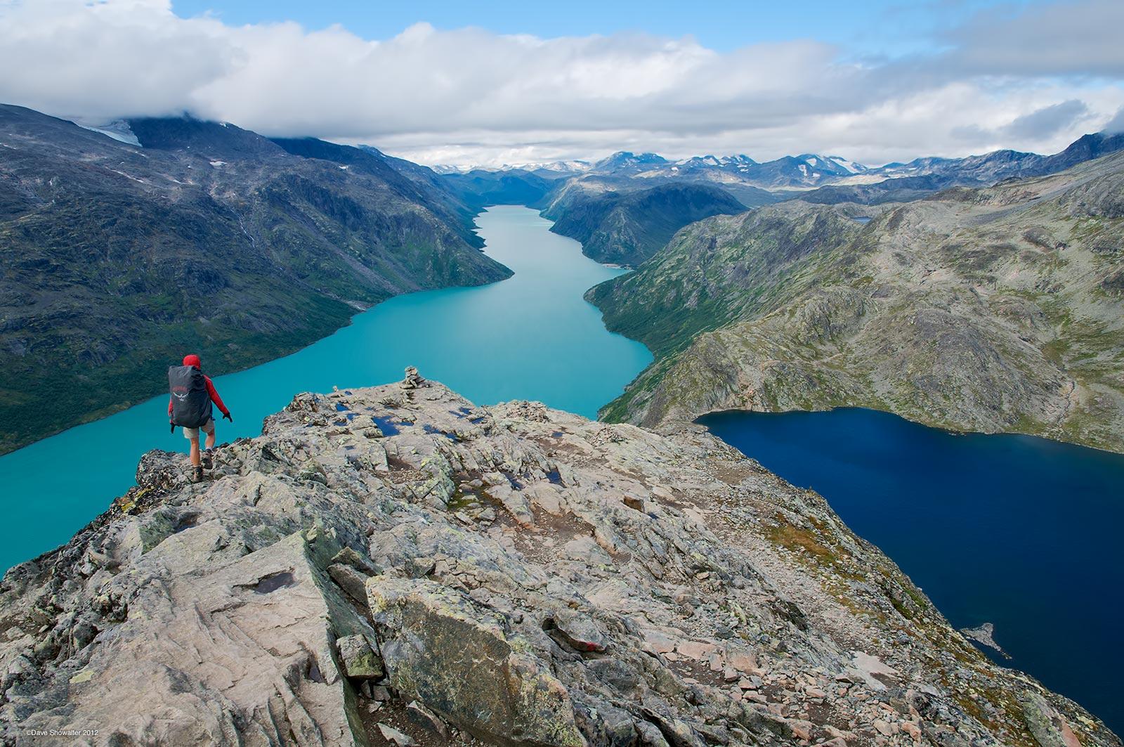 """Trekking hut to hut in Jottenheimen, Norway's """"Land Of The Giants"""", Marla crests Bessegen Ridge with snow-capped peaks in the..."""