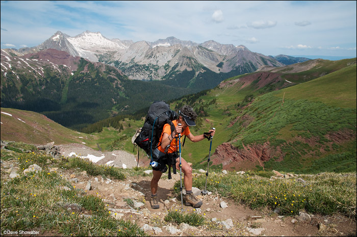 With a backdrop of Snowmass Mountain (14,092') and Capitol Peak (14,130'), Marla digs for the top of Buckskin Pass. Buckskin...