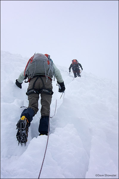 """Marla is led by our guide Marco on the last pitch of Diablo Mudo's (5223m) """"penitente"""" studded glacier. Considered an easy peak..."""