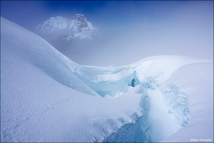 A crevasse high on Pisco Peak leads to a view of Huascaran, 6,768 meters. The high Cordillera Blanca is a land of ice - what...