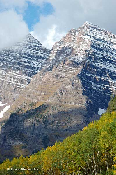 Maroon Peak, 14,165' and North Maroon Peak, 14,014' are decorated with golden aspen trees.