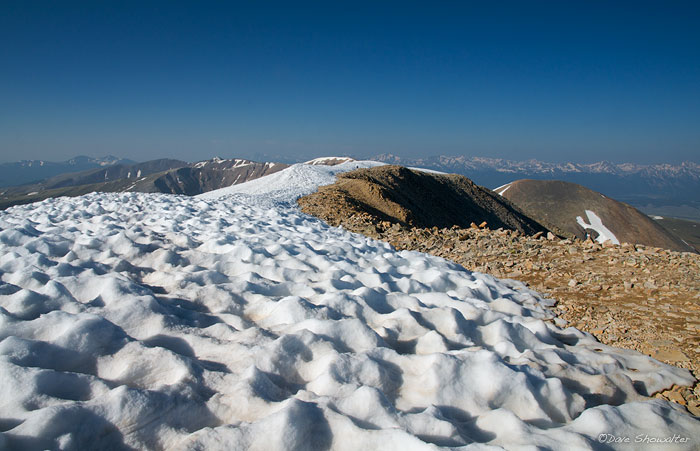 Sun-cupped snow lines the high ridege to Mount Sherman's summit. This 14,036' peak is considered by many to be Colorado's easiest...