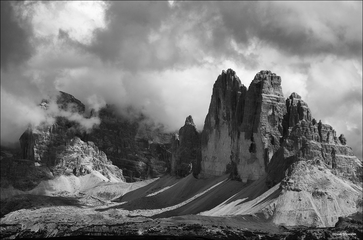 "Clouds swirl around Tre Cime Di Lavaredo, or ""Three Peaks of Lavaredo"" in the Dolomite Alps. These iconic peaks formed..."