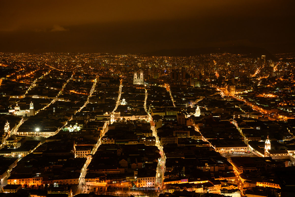 The city of Quito sparkles in evening lights from high above the city at the Virgin of Quito statue. The Basilica del Voto Nacional...