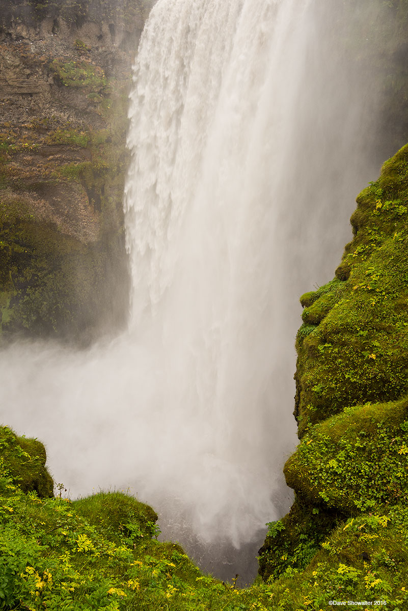 Skogafoss waterfall on the Skoga Riverplunges 60 meters (200 feet)over cliffs that once formed the coastline in south...